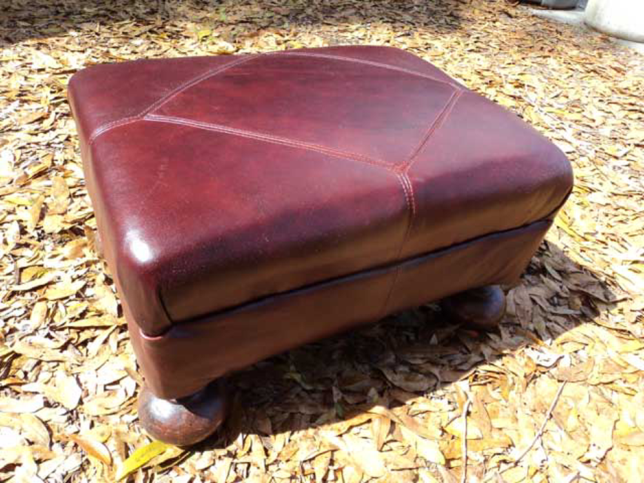 Footstool in leather